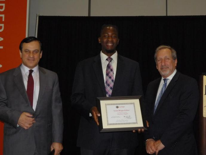 NJIT student Takudzwa Mugabe receives award from Bob Nardi and Dr. Sotirios Ziavras